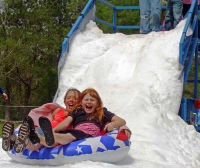 Girls Tubing Down Snow Slide Ride In Houston
