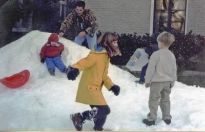 Houston Kids Playing On Blown Snow Hill