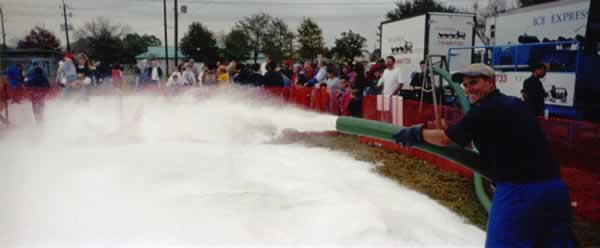 Snow Blowing Machine Covering Event Grounds